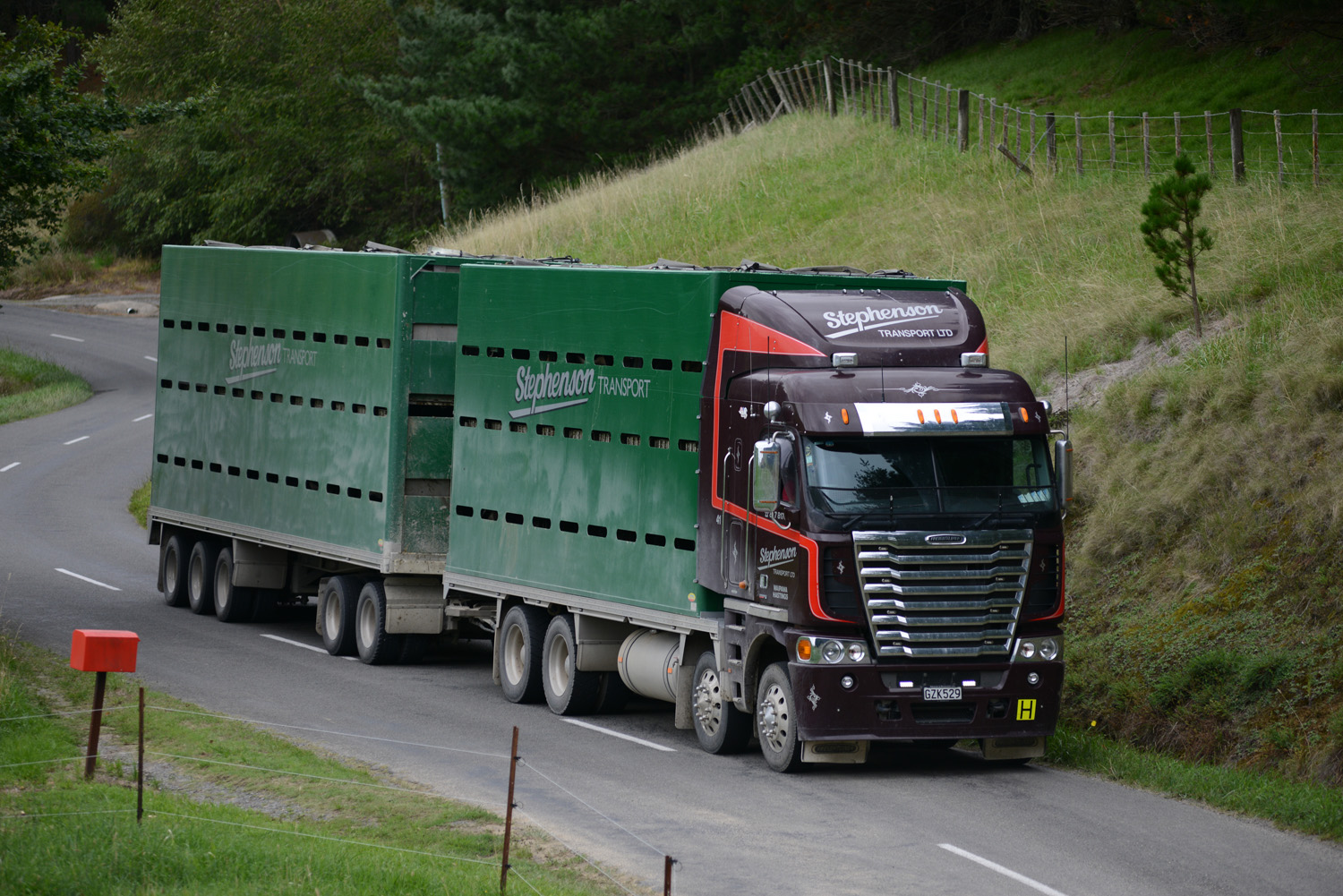 Freightliner truck driving on a windy hill