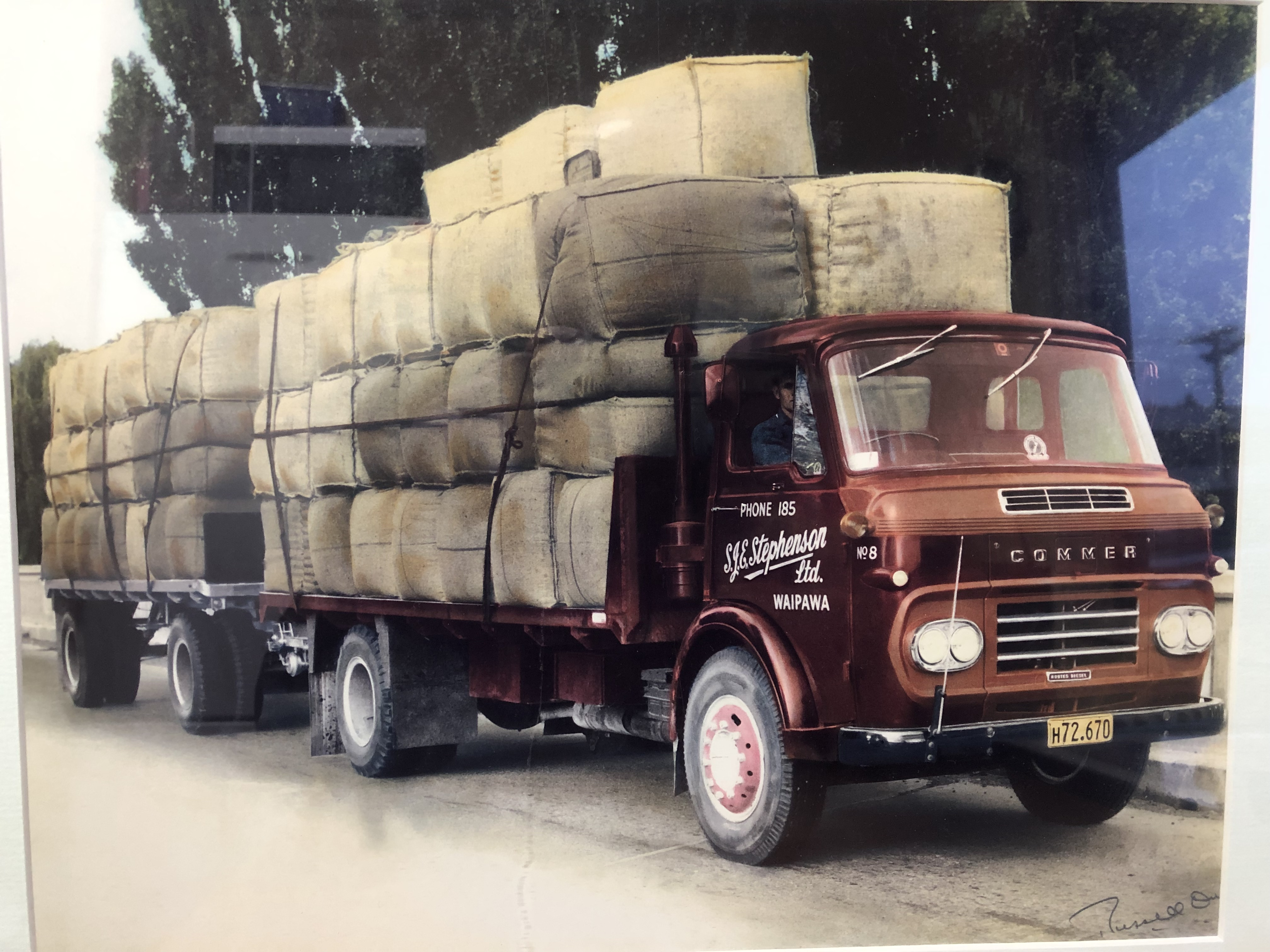 Colour photo of a SJE Transport truck
